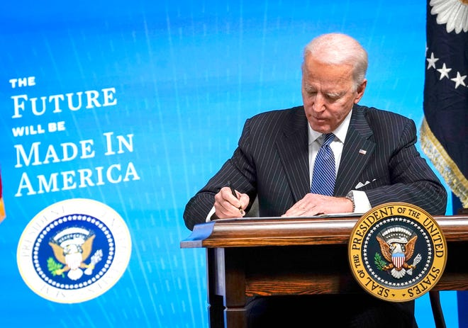 U.S. President Joe Biden signs an executive order related to American manufacturing in the South Court Auditorium of the White House complex on Jan. 25, 2021, in Washington, D.C.