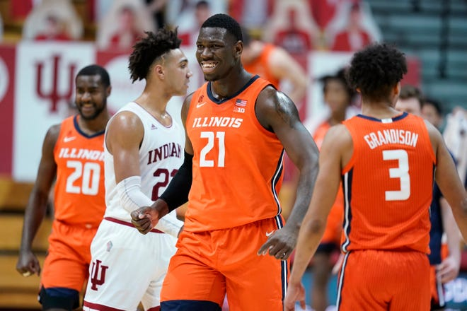 Illinois' Kofi Cockburn (21) smiles after a dunk during overtime in the team's NCAA college basketball game against Indiana, Tuesday, in Bloomington, Ind. Illinois won 75-71.