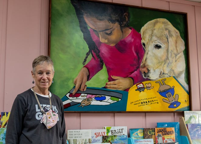 The painting of Janet Mills' granddaughter and dog Rhythm hangs in Rhythm & Co. Books in the Downtown Square in Glen Rose.