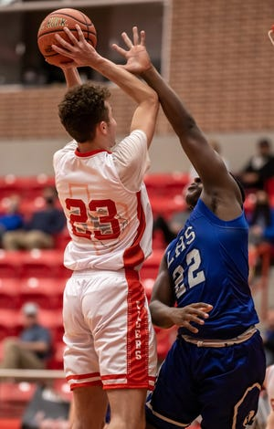 Glen Rose's Caden Schinagel scores two of his 19 points in the Tigers' 60-57 win over Lampasas on Tuesday night at Tiger Arena.