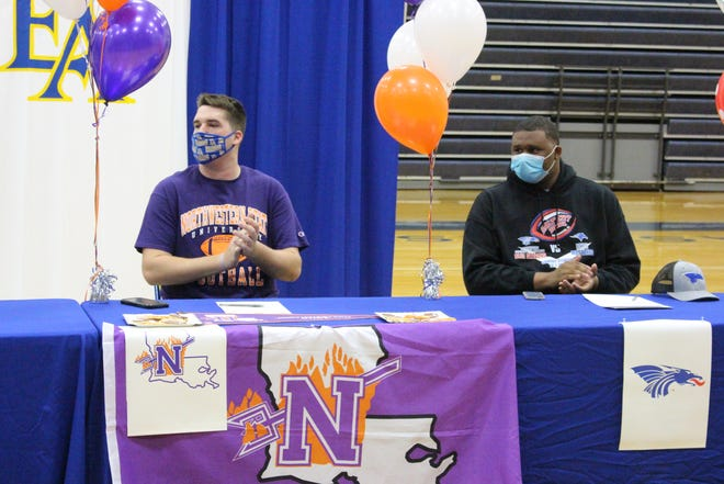 East Ascension's Canaan Quinn (left) and Dezmond Schuster were among the six Spartans to sign with colleges on National Signing Day.