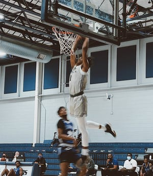 Grayson College's Tyrone Williams dunks during the Vikings conference-opening victory over Ranger College.