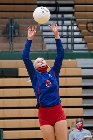 West Henderson's Malia Moore sets the ball during a match at A.C. Reynolds earlier this season.