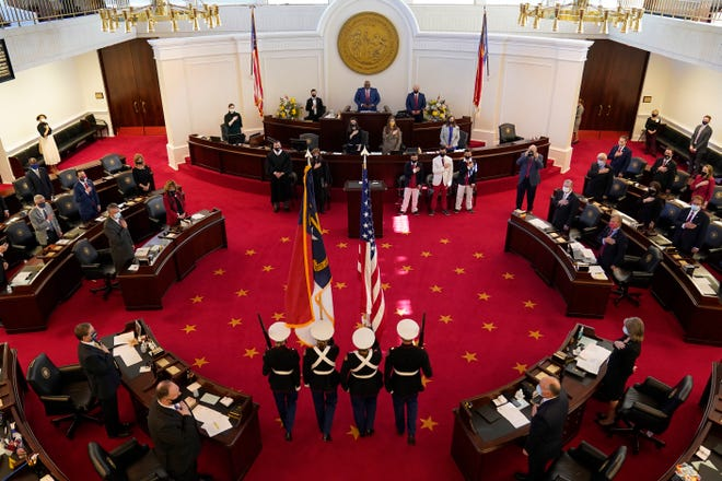 A Marine color guard marches into the Senate chamber during the opening session of the North Carolina General Assembly in Raleigh Wednesday, Jan. 13, 2021. (AP Photo/Gerry Broome)