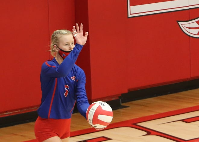 West Henderson senior Malia Moore gets ready to serve during a match at Erwin earlier this season.