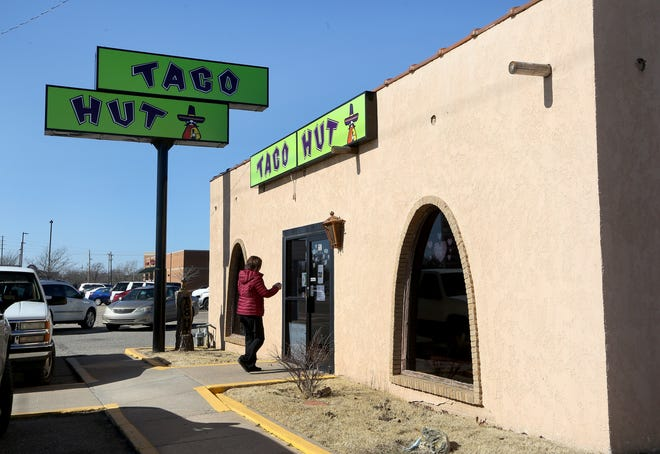A customer walks into the Taco Hut restaurant Thursday afternoon at 600 East 30th Ave. A GoFundMe account has been set up to help the small business which has been struggling during the pandemic.