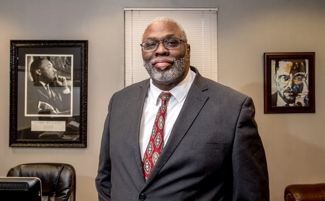 Larry Ivory, president and CEO of the Illinois State Black Chamber of Commerce and chairman of the board of the National Black Chamber of Commerce, poses in his office on the 14th floor of 411 N. Hamilton Blvd. in Downtown Peoria.