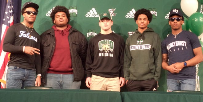 Five Nordonia football player signed letters of intent to continue their career at the college level Wednesday. Signees included, from left, Michael Westbrooks (Notre Dame College), Giaunni Armstrong (Hocking College), Sal Perrine (Ohio University, wrestling), Jon Banks (Mercyhurst University) and Shane Robinson (Mercyhurst.)