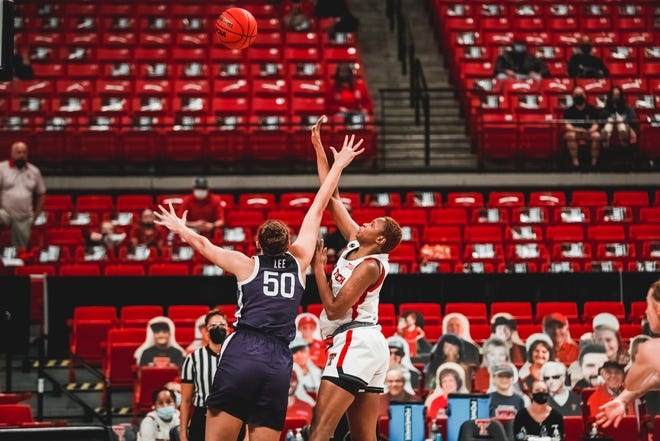 Texas Tech's Khadija Faye attempts a shot during a Big 12 Conference game Wednesday against Kansas State at United Supermarkets Arena. Faye, a freshman, finished with 20 points and 14 rebounds — both career highs — to lead the Raiders to an 83-75 overtime win.
