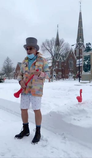 In this screenshot from a live video posted on his Facebook page, Leominster Mayor Dean Mazzarella stands in front of Featherstone the pink flamingo, who predicted an early spring for 2021 after seeing his shadow, the morning of Tuesday, Feb. 2 on the Leominster Common.
