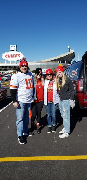 Michele Herbert (center right) stands with her family outside of Arrowhead Stadium.