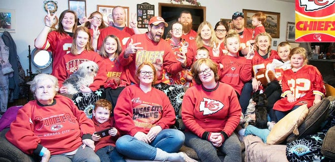 Kirk Warman (top center) is surrounded by family at his home in Iberia after the Chiefs won Super Bowl LIV over the San Francisco 49ers on February 2, 2020.