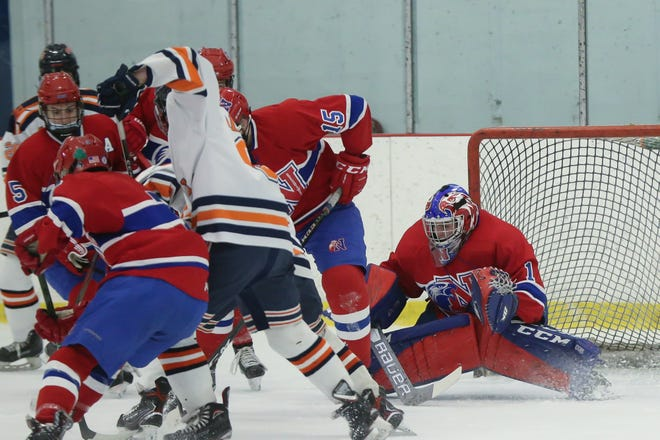 Natick junior goaltender Luc Gagnon makes a save during the game against Walpole High School at Rodman Arena in Walpole, Feb. 3, 2021. The Redhawks and Rebels skated to a 1-1 tie.