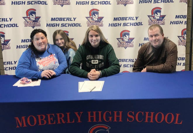 Moberly High School senior Isabella Ross signed a letter of intent on Jan. 29 announcing she accepted a cross country and women's track scholarship while attending Central Methodist University in Fayette for the 2021-22 college year. Isabella is seated between her mother, Tiffany  Ross (left) and Rob Kloski, and behind her mother is Isabella's freshman sister Chloe.  Ross qualified for the MSHSAA Cross County Championships all four varsity years under Spartans head coach Greg Carroll.