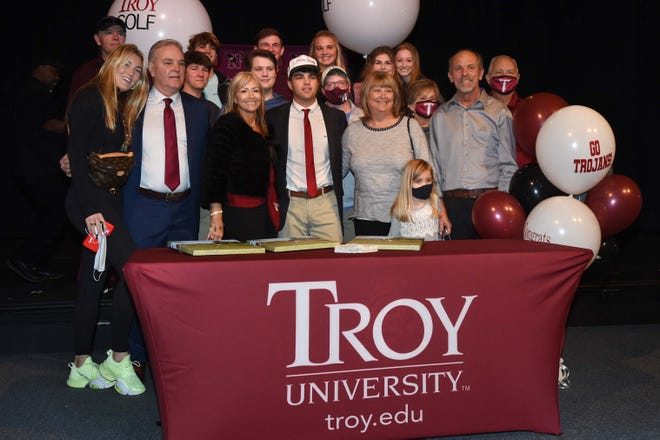 Niceville's Blake Rigdon is surrounded by family and friends as he poses for a picture after a signing ceremony at the school Wednesday. Rigdon will be heading to Troy University.