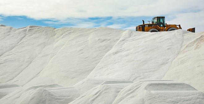 Road salt looks like snow piled high at the Quincy Shipyard on Thursday, Feb. 4, 2021.
