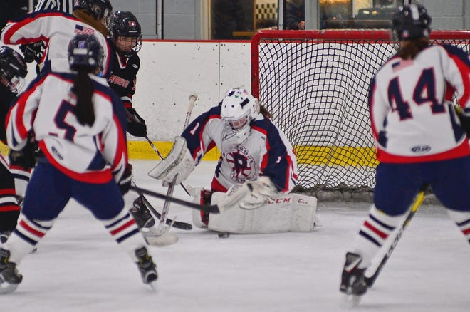 Pembroke's Kaleigh Murphy makes a save against Hingham on Jan. 22, 2020.