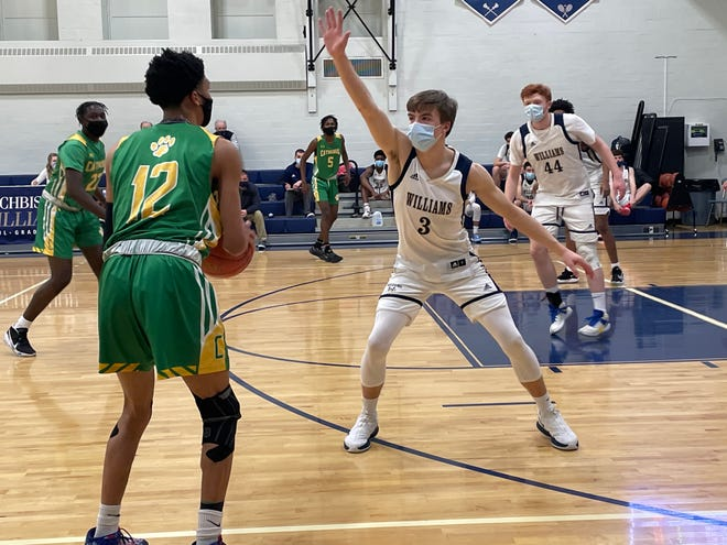 Archbishop William's Brendan Kubik defends a Cathedral player on Wednesday, Feb. 3, 2021.