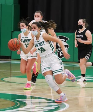 Dwight senior Kayla Kodat charges up the floor after a recovery of a loose ball against Midland Wednesday night. Kodat scored 35 points to lead the Trojans to a 66-49 victory.
