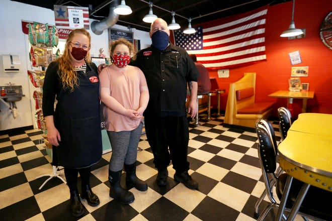 From left, Mo Donovan, her daughter, Sophie, 10, and her husband, Jim, inside Earl's Steak Sandwiches in Dover on Thursday, Feb. 4, 2021.