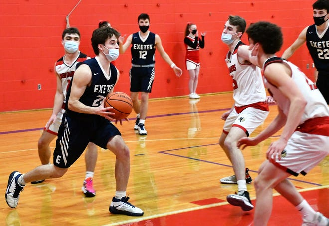 Exeter's Tom Delgado, left, scored 16 of his game-high 19 points during a 36-point second quarter that sparked the Blue Hawks to a 74-46 Division I win at Spaulding on Wednesday.