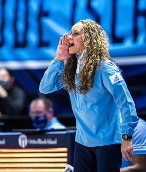 URI women's basketball coach Tammi Reiss shouts instructions from the sideline during a recent game. The Rams enter Friday's contest on their longest winning streak in the Atlantic 10 since the 1995-96 season.