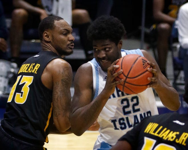 URI center Makhel Mitchell looks for a way to the hoop versus VCU's Corey Douglas Jr. in a Feb. 3 game at the Ryan Center.