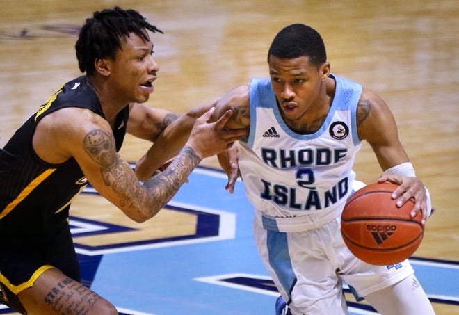 Rhody guard Jeremy Sheppard drives around VCU's Adrian Baldwin Jr. during a game in February. URI will have just one regular-season game against VCU this season.