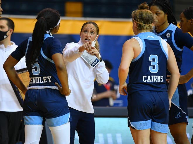 URI women's basketball coach Tammi Reiss speaks with her players during a recent game. She has been named the league's Coach of the Year while forward EmmanuelleTahaneis co-Player of the Year.