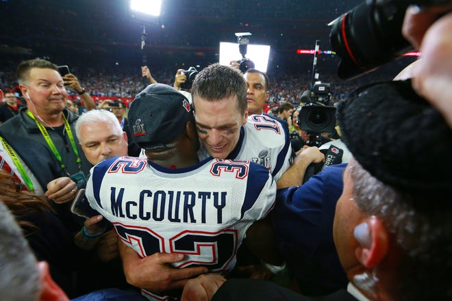 "On Feb. 5, 2017, quarterback Tom Brady and safety Devin McCourty embrace after they had defeated the Atlanta Falcons in Super Bowl LI at NRG Stadium in Houston. McCourty said this week on his podcast that ""you've got to be happy"" that his longtime teammate is playing in his 10th NFL championship game this weekend."