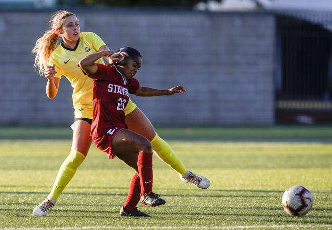 Oregon's Zoe Hasenauer, left, and Stanford's Kiki Pickett battle for the ball during a Pac-12 Conference game at Pape Field.
