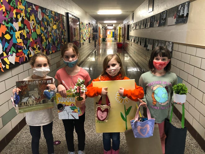 Clearmount Elementary students (left to right) Aubrey Palsa, Adelyn Palsa, Cassidy Cecil and Meredith Janaske display a sample of items collected by the student body for assisted living facility residents.