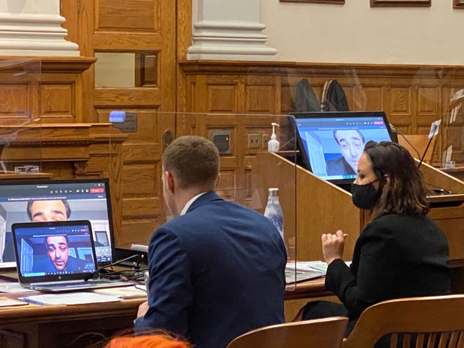 Defense attorney Pierce Walker sits next to Stephanie Anderson, of the Ohio Attorney General's Office, and cross-examines a prosecution witness through a video link on Thursday on the second day of Classie Hawthorne's trial in the 2018 shooting death of her husband, Cleveland Hawthorne.