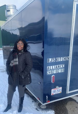 Brenda Johnson, owner of BJ's Kitchen, a mobile food truck that made a stop Thursday at lunchtime in Alliance.
