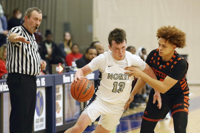Keigan Powe, right, Freeport's only returning starter this year, is shown guarding Belvidere North's Caden Brannan in March 2020.