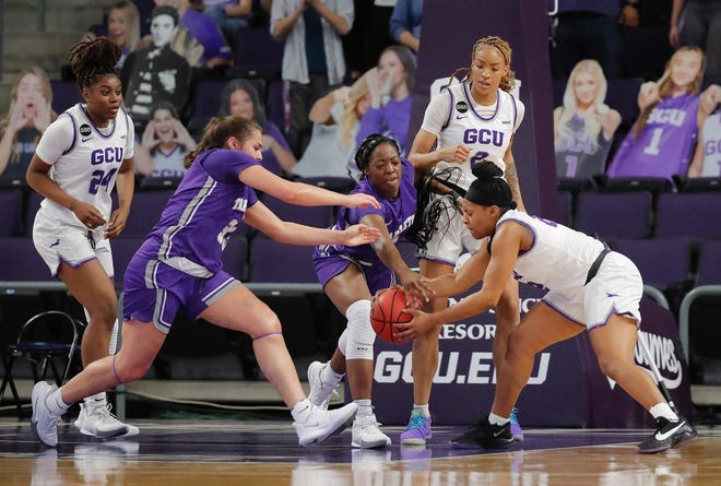 Tarleton's Marissa Escamilla and Lucy Benson try to get the ball from a Grand Canyon player during Tuesday's game at GCU Arena in Phoenix.