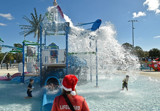 A lifeguard gets into the spirit of the Swim with Santa event in December at the North Port Aquatic Center. The North Port City Commission has approved changes to the operating hours and fee schedules at the center, in part to make staffing needs more predictable.