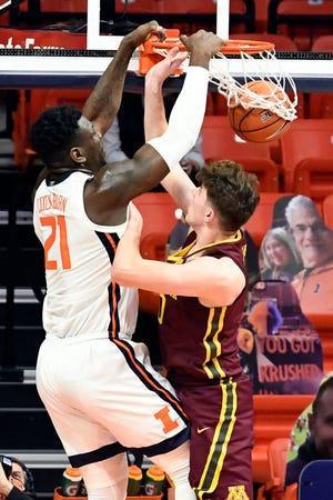 Illinois center Kofi Cockburn (21) dunks on Minnesota's center Liam Robbins (0) Tuesday, Dec. 15, 2020, in Champaign. [Holly Hart/The Associated Press]