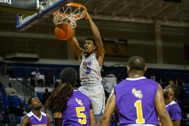 Savannah State's Trey DeLoach, a Richmond Hill High School graduate, dunks on Benedict College at Tiger Arena on Jan. 25, 2020.