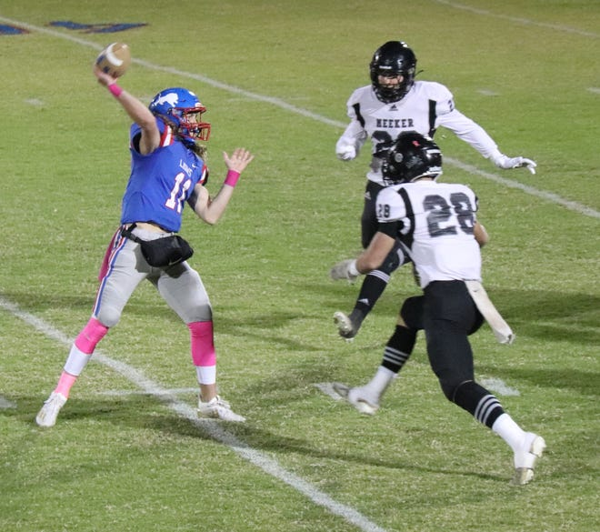 Meeker's Caden Wolford (28) applies pressure against Chandler during the 2020 season.