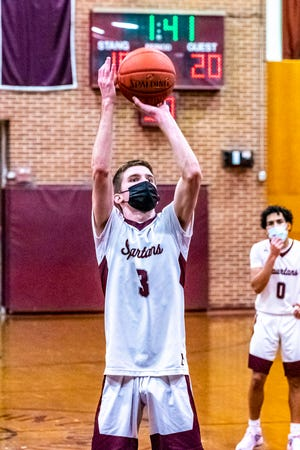 Declan Markey, seen in a game earlier this season, scored 31 points on Saturday to help the Spartans capture their first win of 2021.