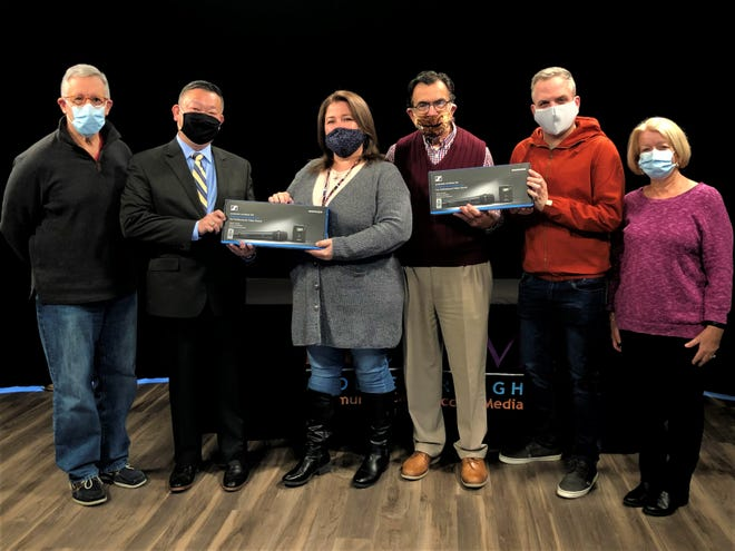 Rotary Club Members recently donated two wireless microphones to MCCAM as thanks for helping with the annual Rotary Club Charity Auction. Here, Rotary Club members, from left, Peter Regas, Albert Mui, Karen Foye of MCCAM, Bob Saquet, Zach Grundy and Sue Okolita.