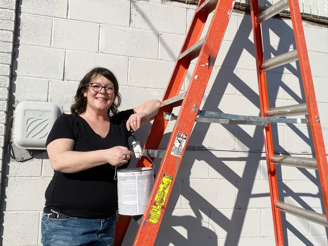 Artist Jenna Spencer beginning prep on her eighth mural in downtown Pittsburg on Wednesday, Feb. 3.