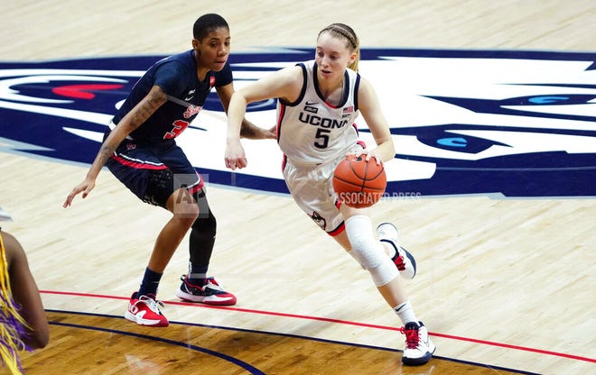 Connecticut guard Paige Bueckers (5) drives the ball against St. John's guard Kadaja Bailey (30) during the first half of an NCAA college basketball game Wednesday, Feb. 3, 2021, in Storrs, Conn.