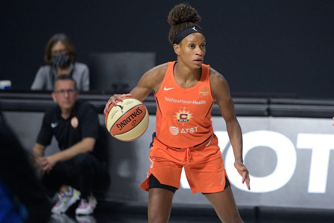 Connecticut Sun guard Jasmine Thomas sets up a play during the second half of a WNBA basketball first round playoff game against the Chicago Sky, Tuesday, Sept. 15, 2020, in Bradenton, Fla.