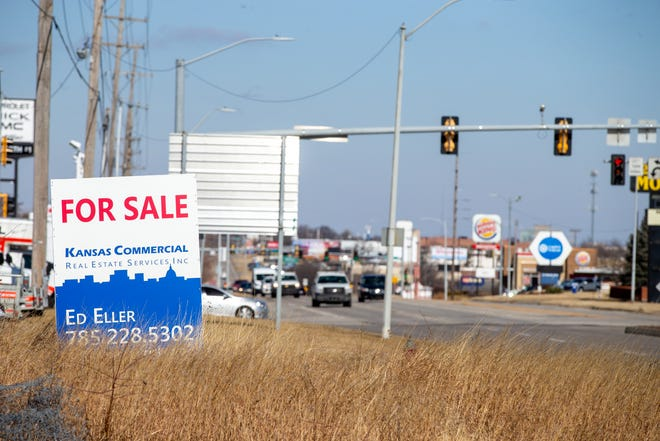 "A ""for sale"" sign grabs the attention of developers potentially looking to invest in land next to S.W. Topeka Boulevard. That major road is expected to be the site of restoration projects in coming years."