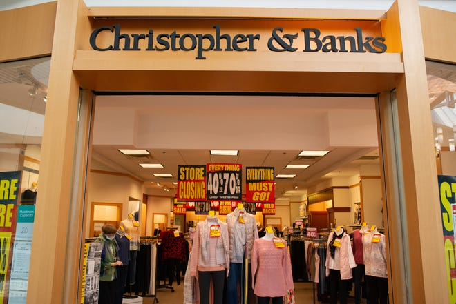 Sale signs litter the Christopher & Banks retail store within West Ridge Mall Thursday, as the company prepares to close most of its brick-and-mortar locations. Christopher & Banks Corporation filed for Chapter 11 bankruptcy last month.