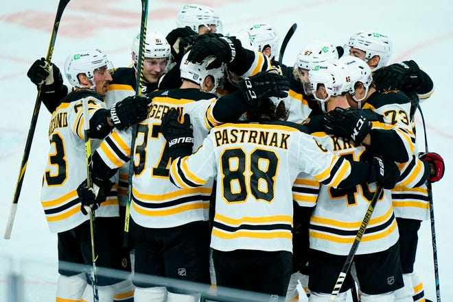 Boston's Patrice Bergeron (37) celebrates with teammates after scoring the winning goal during overtime on Wednesday.