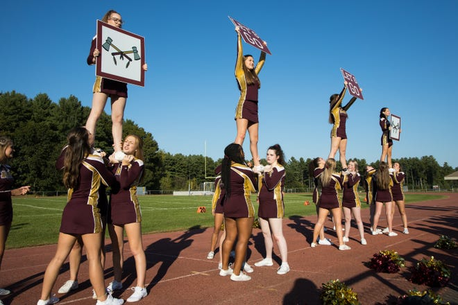 Algonquin cheerleaders perform on the sidelines during a 2019 game.