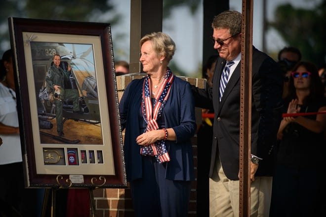 Dale and Ann Hampton look at a portrait of their late daughter, Kimberly Hampton, Thursday, Oct. 2, 2014, at the dedication ceremony of Kimberly Hampton Primary School on Fort Bragg.